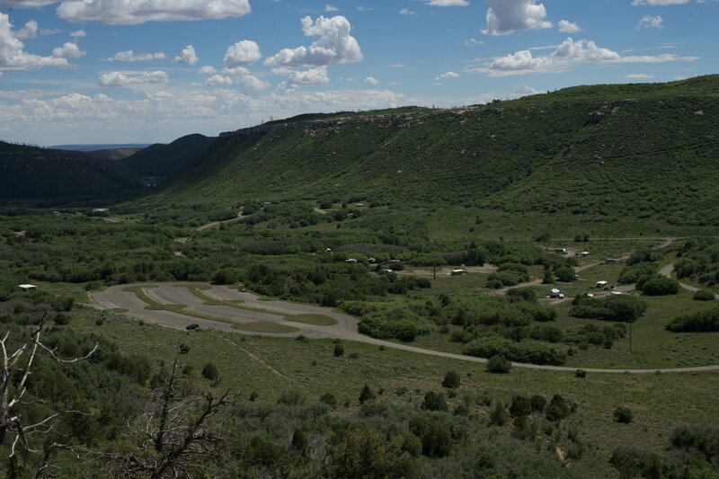 Looking back at the parking area and Morefield Campground from the trail as it climbs the hillside.