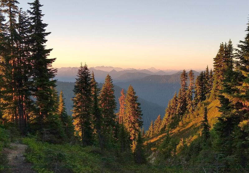 Dawn breaking high in the mountains at Lake Sally Ann Trail camp along the PCT.