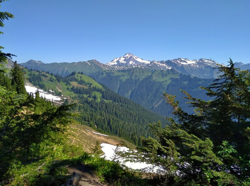 Snowy Glacier Peak is in the distance to the north, seen from a lookout at the Bald Eagle/Blue Lake High Trail junction.