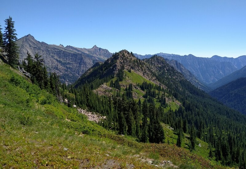 Mountains to the northeast emerge high on Wenatchee Ridge Trail. Whittier Peak, 7,281 ft., is the pointy peak on the far left.