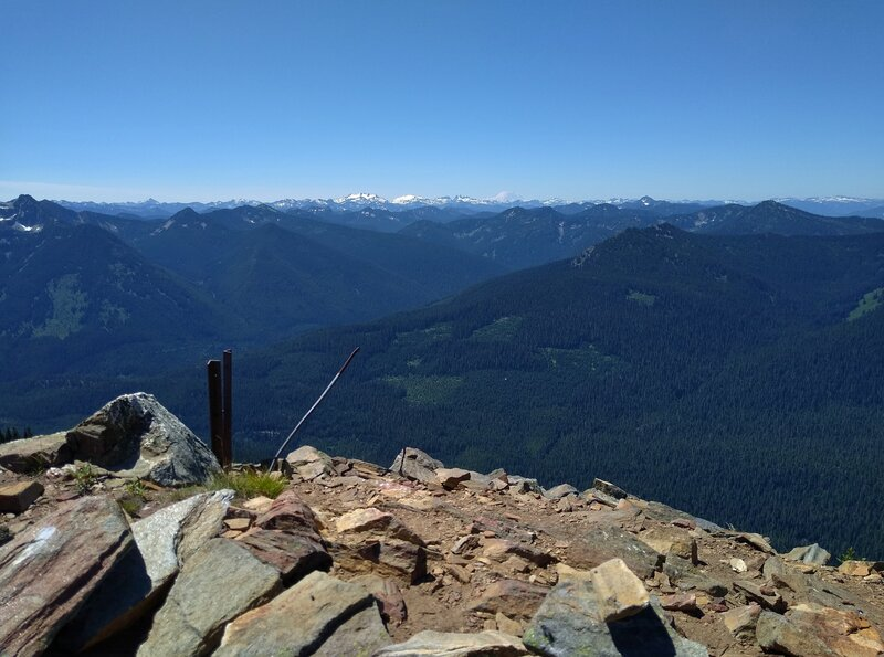 Distant mountains, including snow covered Mt. Rainier, 14,411 ft. (center right), Are seen looking southwest from the Poe Mountain summit - 6,015 ft.
