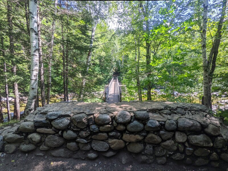 Transition from Lincoln Woods Trail to Franconia Brooks Trail.