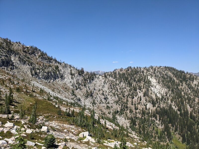 View of trail switchbacking up slope.