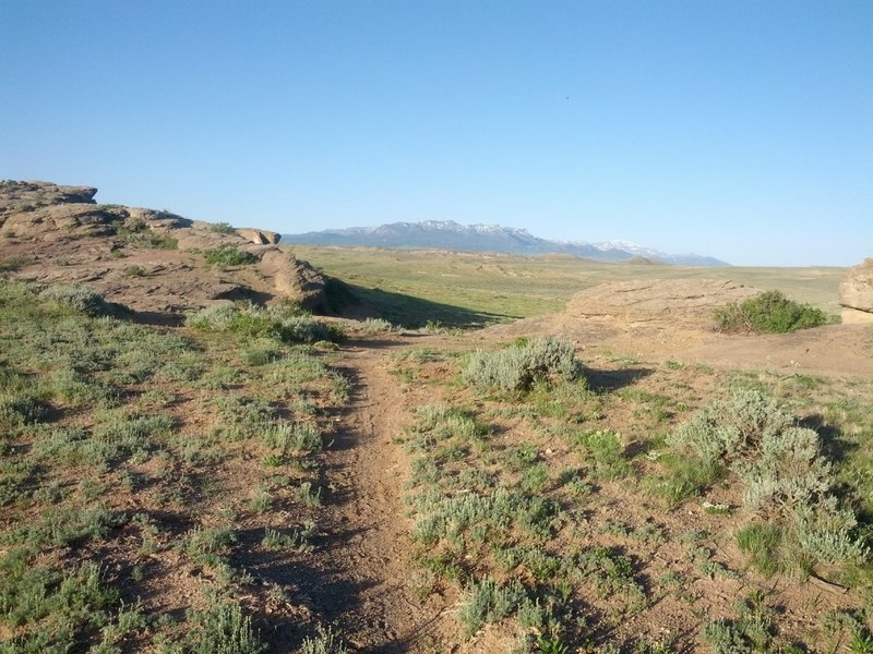 """The low point in the """"rock garden"""" with Carter Mountain in the background. On the return, you'll ride down the rocks on your left and cross over this trail."""