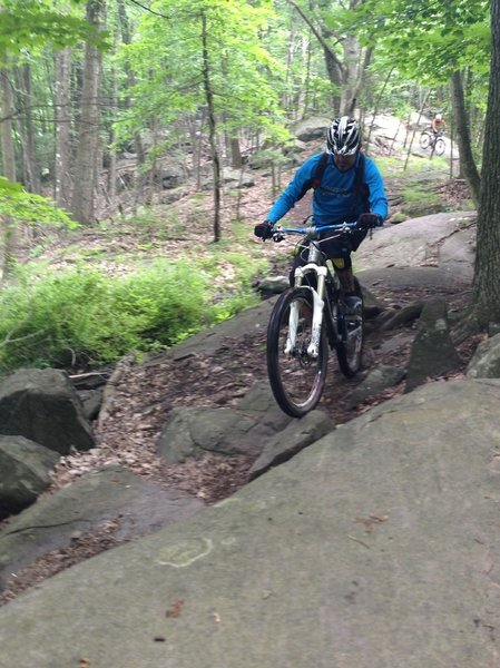 Negotiating the boulders along MYX Monster trail