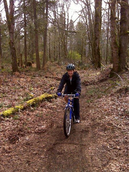 Laura cycling through Soaring Eagle