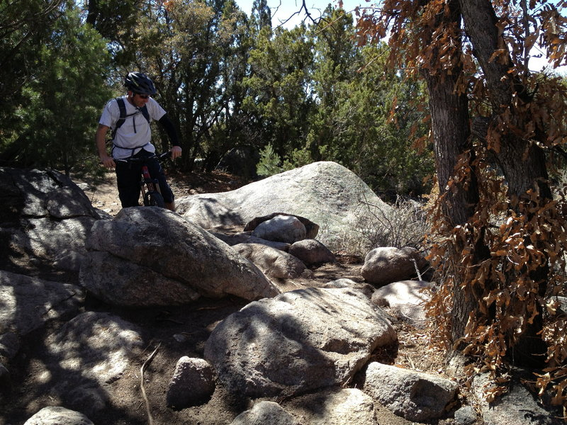 Lance trying to figure out what to do with the embedded boulders