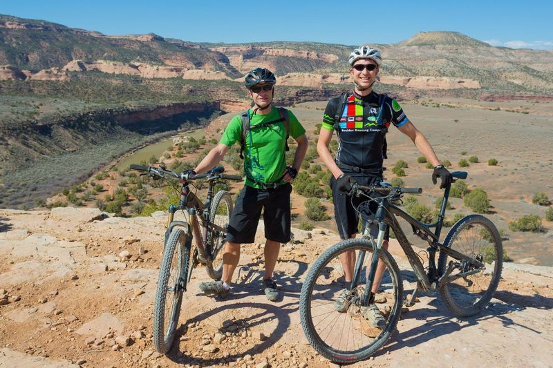 """Nick and Mike, two of the three founders of MTB Project, hard at """"work""""!"""