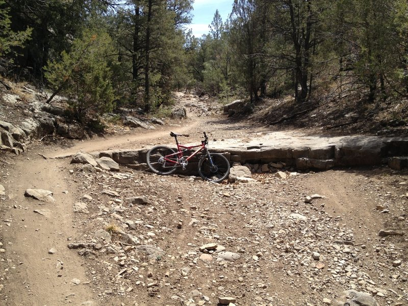 Natural ledge drop in the bottom of the canyon, you could ride around it but why?