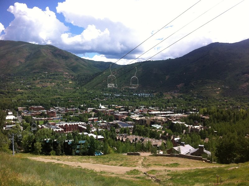 View of downtown Aspen from Ajax Trail.  You can see the popular Smuggler Mt. Rd. traversing up towards the Hunter Creek valley just to the right of the Lift 1A chairs.