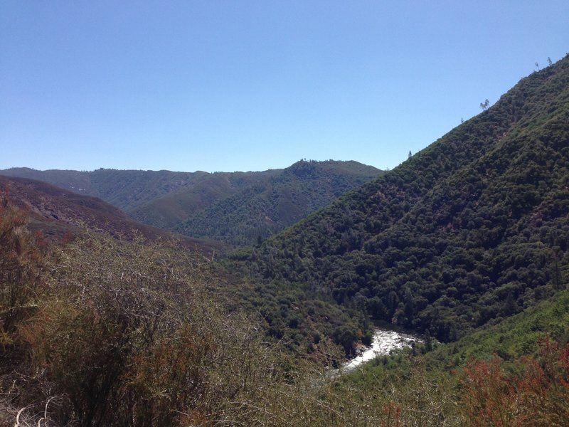 View back at the Tuolumne river and lumsden road on the right side of the river canyon.