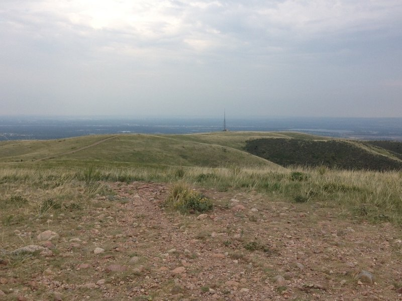 The view from the top of the mountain, a long way traveled with the radio tower and service road visible