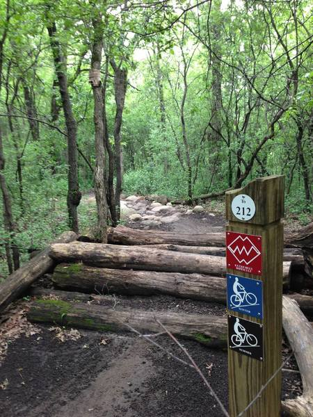 One of many log piles and rock gardens.   This is the entrance (filter) to the XX loop.   (also showing off the great signage available out on the trails)