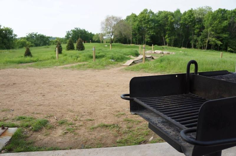 Looking out at the skills park past one of the grills available for use at the brand new trailhead facilities (as of 2012).