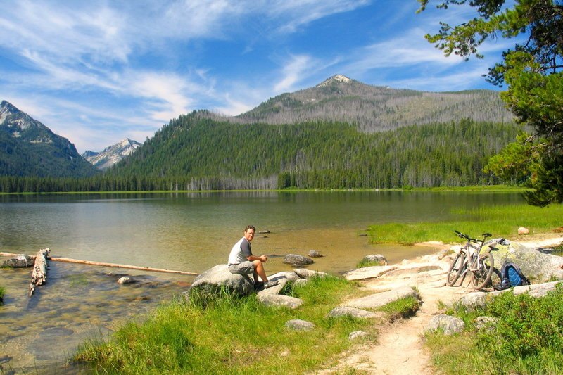 Taking in the gorgeous lake and mountain views from the shoreline of Loon Lake.