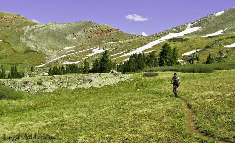 In Our Sights <br> Searle Pass seen up ahead, trail goes right over saddle point