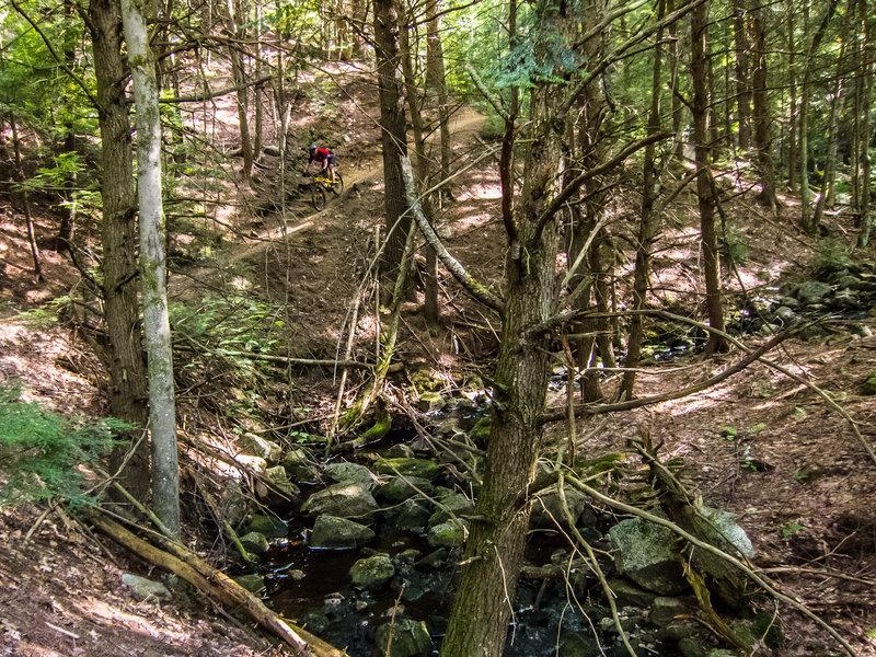 Rider descending Cascade Trail