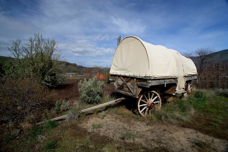 An old wagon next to the parking area reminds you of travelers from long ago.