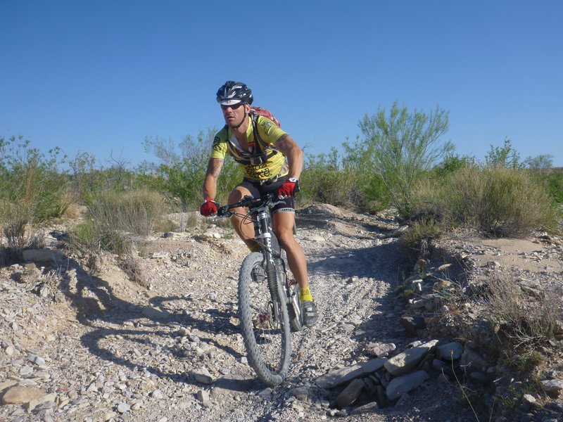 Alex riding the creek bed section at the top of loop 3.