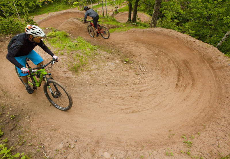 A quick and deep series of berms on the upper reaches of Candyland