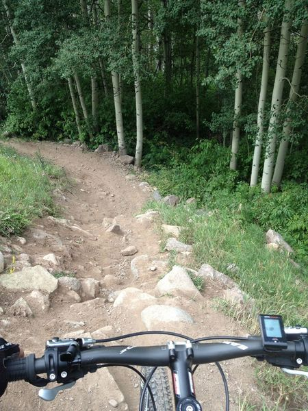 Skip this last section of badly eroding trail and take the dirt road.