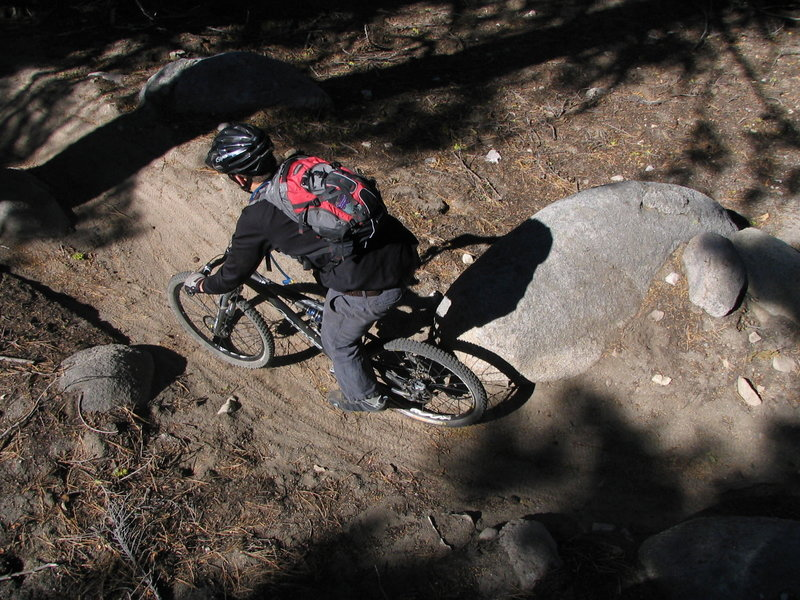Bucky winding his way through the boulders during a late-season ride along the Tahoe Rim Trail.
