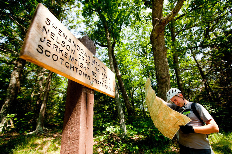 Checking the map at the intersection of Benson Run Rd and the Shenandoah Mountain Trail. Take a left to ride towards an 11 mile singletrack traverse