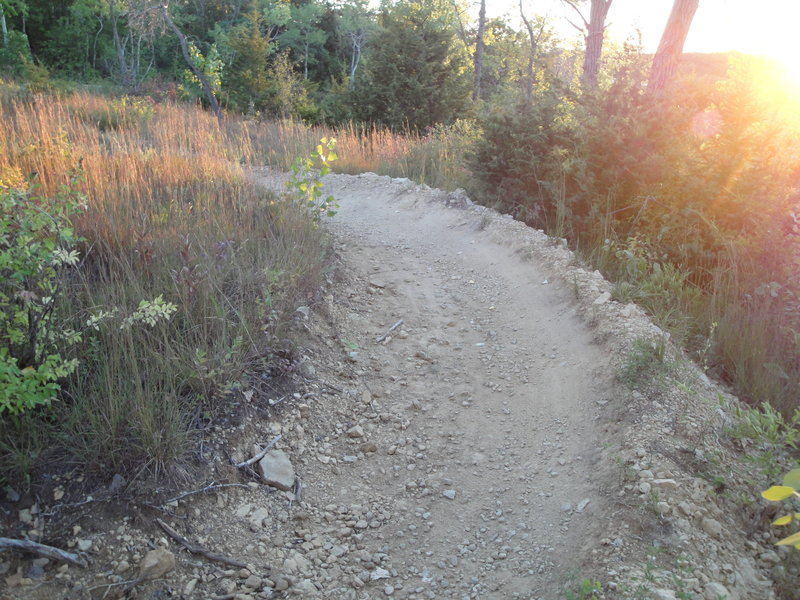 The upper part of the trail is much more rocky than the section along the lake. Here is a flowing berm towards the beginning of the downhill.