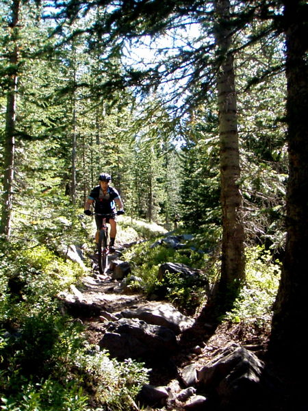 Flying down on of the many narrow, rocky sections of singletrack