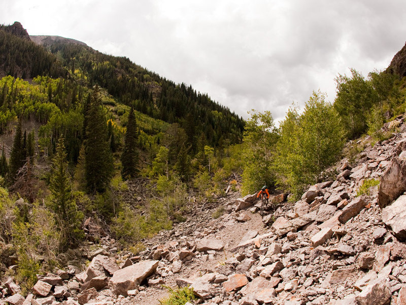 The lower reaches of Silver Creek feature some technical riding, including a big rock drop below a steep cliff.