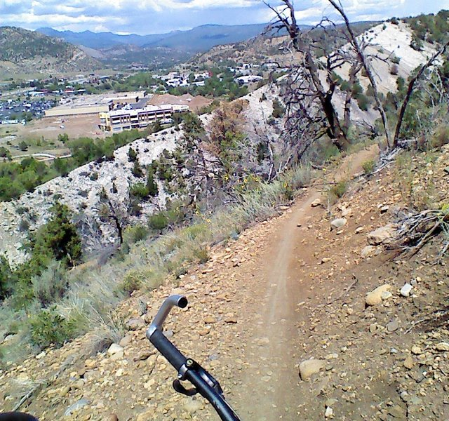 Descent towards Carbon Junction with a sharp ridge and Durango in the background