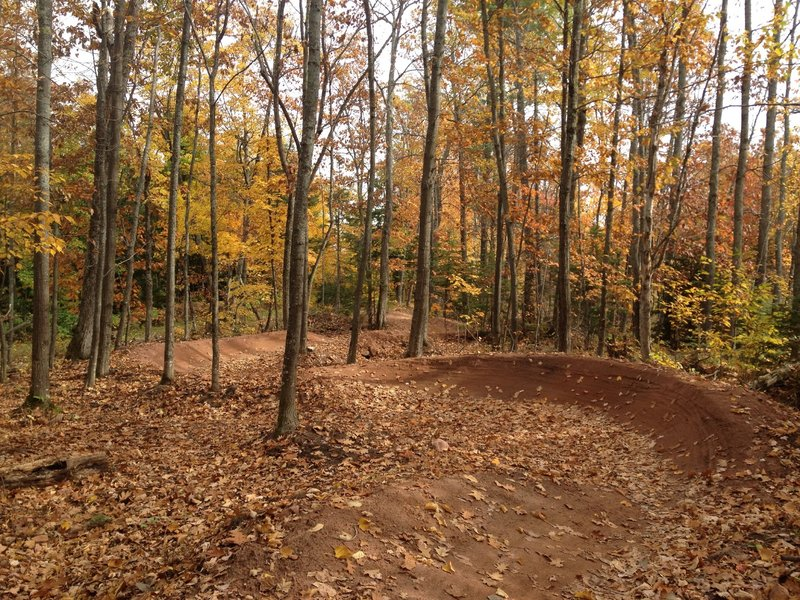 Big linked berms after the first drop on Sure Would.