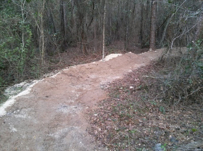Berm located at bottom of first ridge crossing.