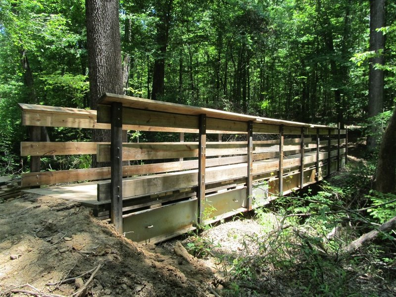 The new steel span bridge on the 3 Bridges Trail. The Forestry Dept provided the bridge and material and the local bikers installed the decking