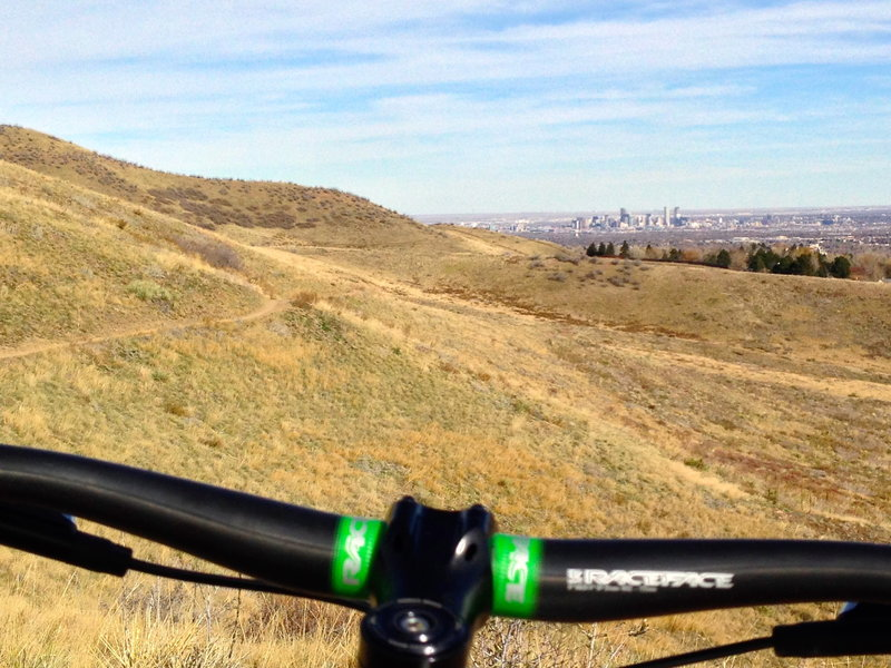 A lookout / resting spot with a distant view of Denver.