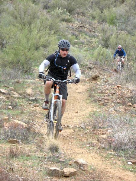 O and Josh riding through the desrt