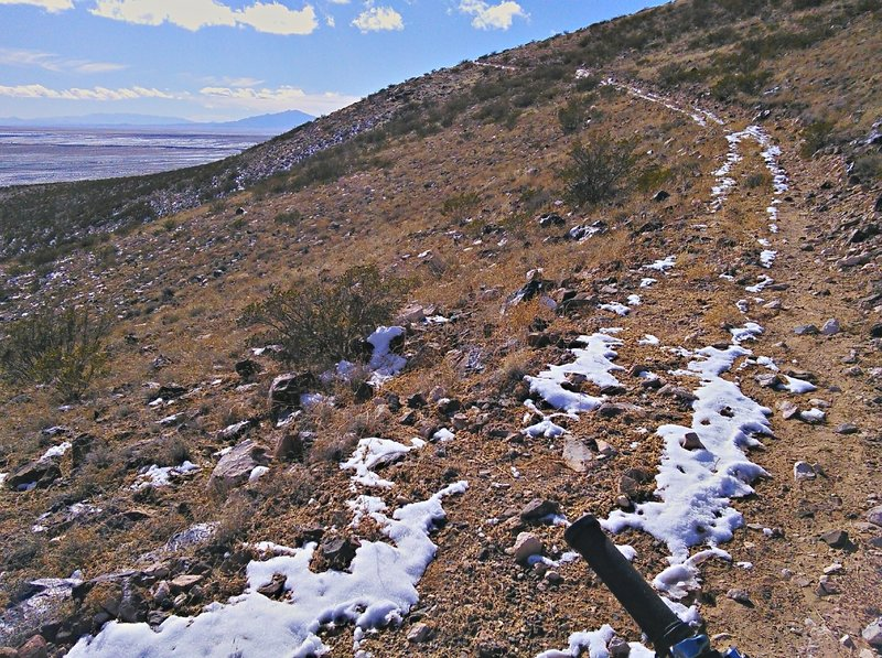 Steady ascent towards the south Cerro peak. The trail is wide but studded with rocks.