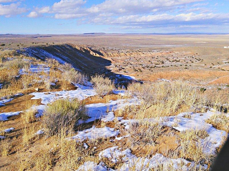 "Trail skirts this escarpment. Below it the ""bowl"" area of El Cerro de Los Lunas Preserve."