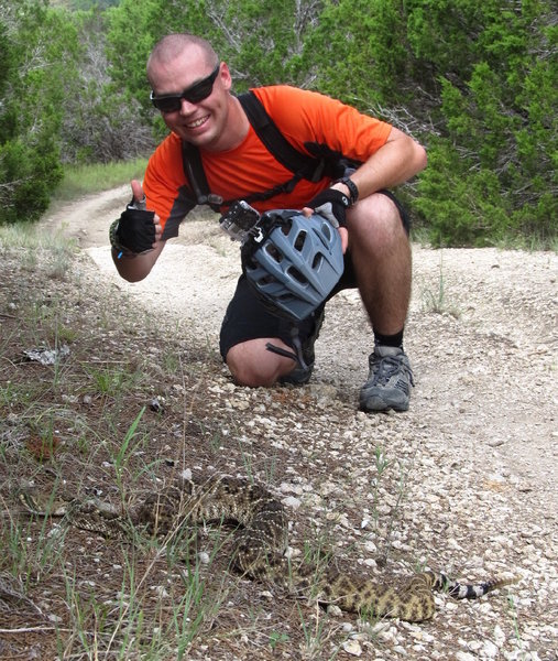 Taylor and a large Eastern Diamondback Rattlesnake along the Fence Line Trail at the Dana Peaks Trail System
