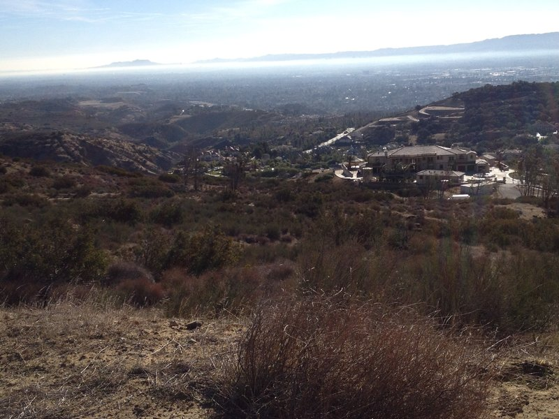 Looking back at the San Fernando Valley and some very large mansions in the area
