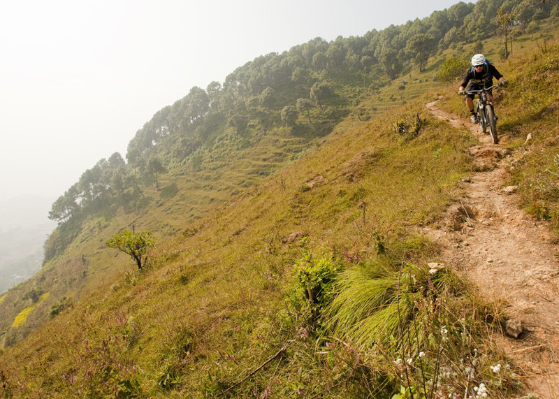 Approaching the staircase high above terraced fields.