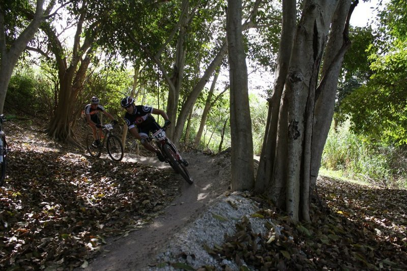 Racers take on one of many large berms in the park