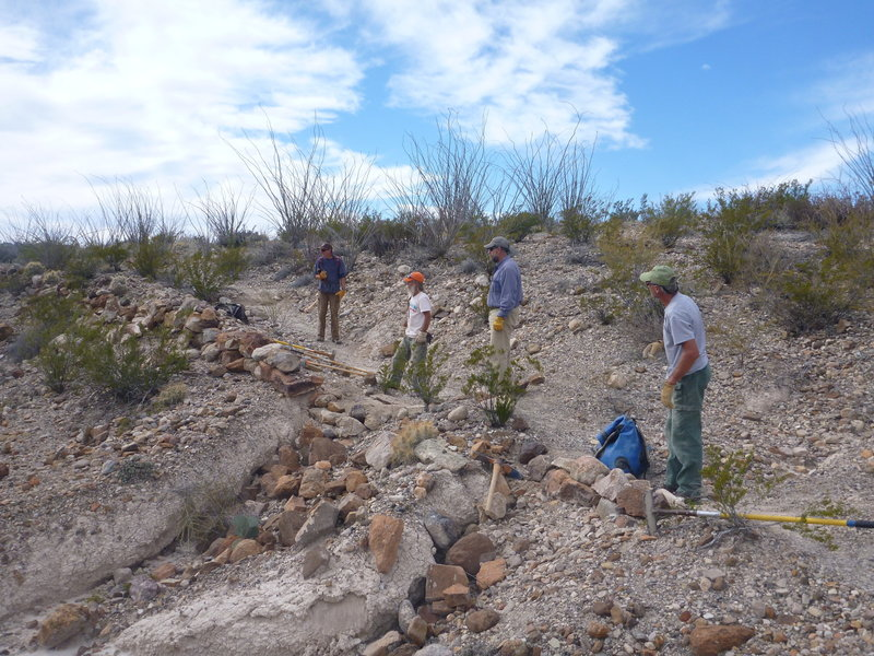 The Big Bend Trails Alliance Volunteers laying rock to protect and old road bed.