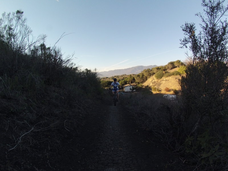 Climbing switchbacks from the upper parking lot