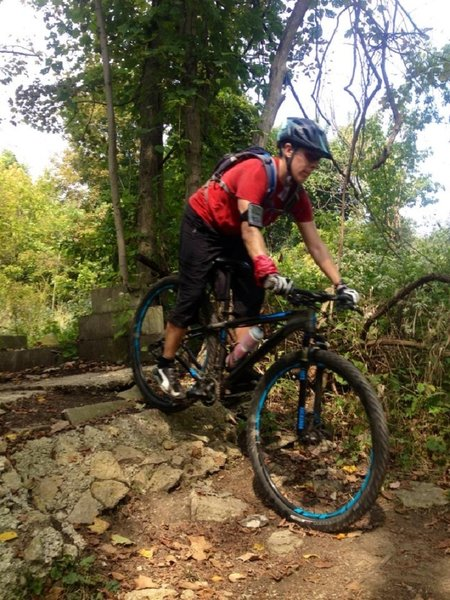 Riding over the foundation on the A trail