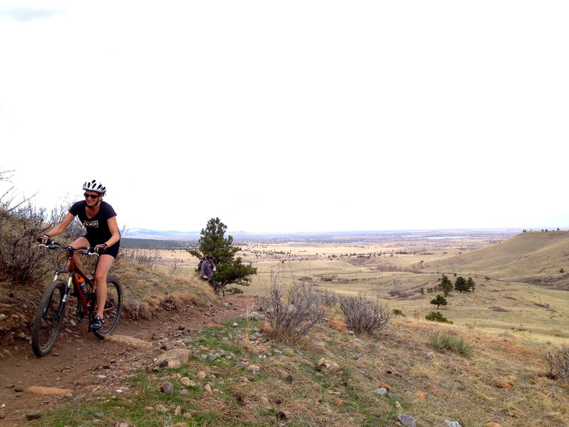 Climbing up with great views across the plains behind.