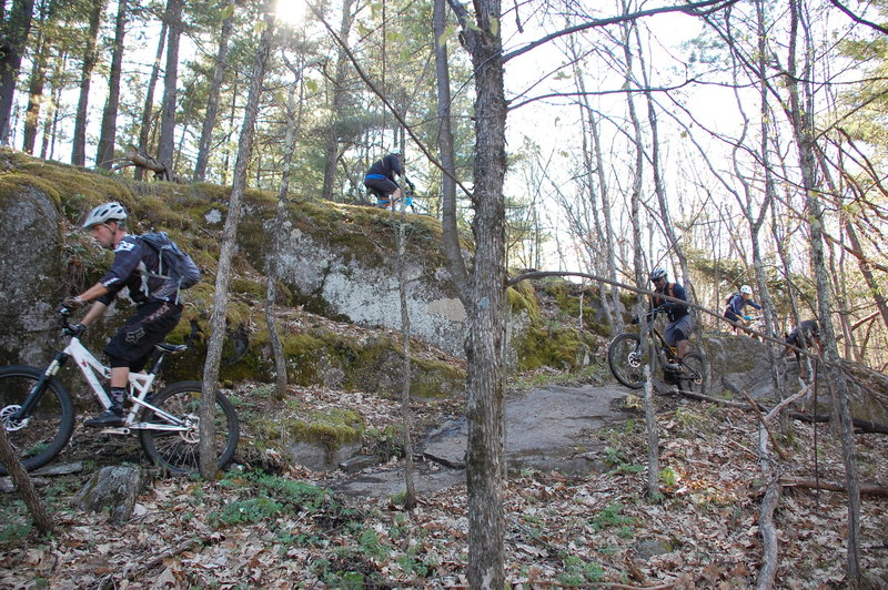 Riders clearing the hairpin turn on Good Luck ledge
