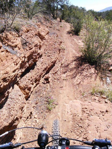 Narrow trail going in to a tight arroyo V-turn