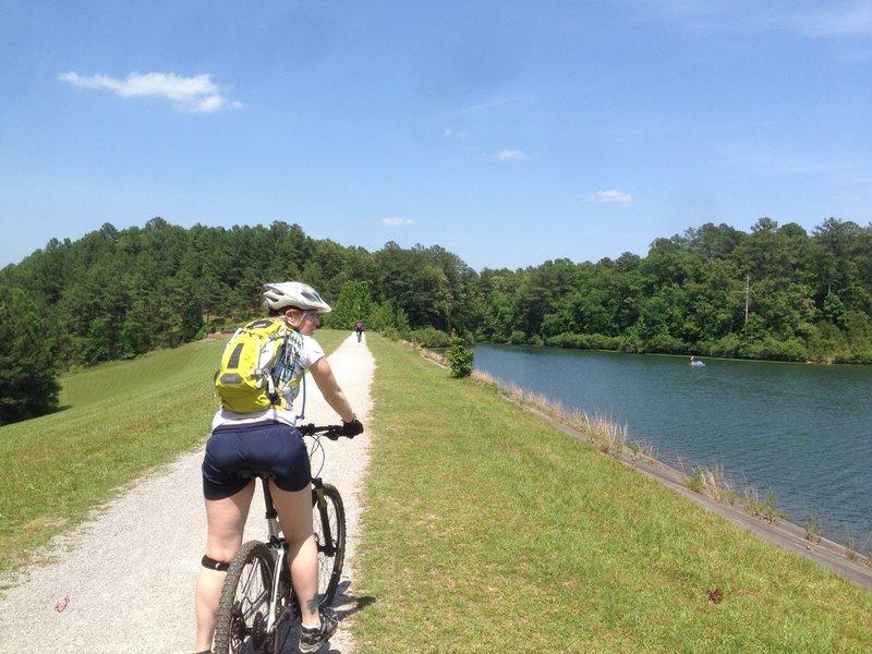 Riding the Lake Trail across the dam that impounds Double Oak Lake at Oak Mountain State Park.