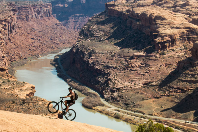 You can see the last section of the Porcupine Rim trail in the background. Wheelies are fun.